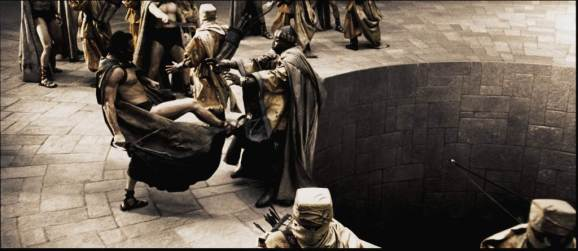 """Leonidas (GERARD BUTLER) personally delivers his answer to the Persian Messenger (PETER MENSAH) in Warner Bros. Pictures', Legendary Pictures' and Virtual Studios' action drama """"300,"""" distributed by Warner Bros. Pictures. PHOTOGRAPHS TO BE USED SOLELY FOR ADVERTISING, PROMOTION, PUBLICITY OR REVIEWS OF THIS SPECIFIC MOTION PICTURE AND TO REMAIN THE PROPERTY OF THE STUDIO. NOT FOR SALE OR REDISTRIBUTION"""