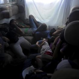 Syrian migrants rest on a train as it travels through FYROM August 2, 2015. REUTERS/Ognen Teofilovski