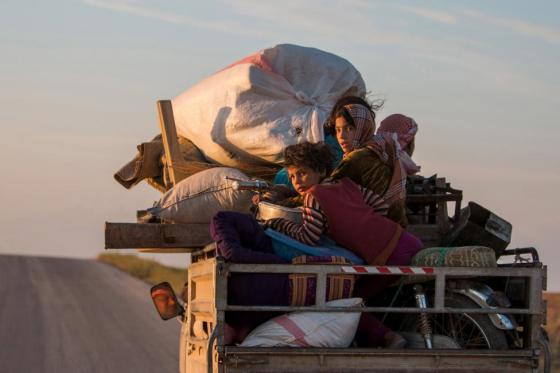 Residents, with their belongings, return to their villages on a pickup truck in the southern countryside of Ras al-Ain May 13, 2015. REUTERS/Rodi Said