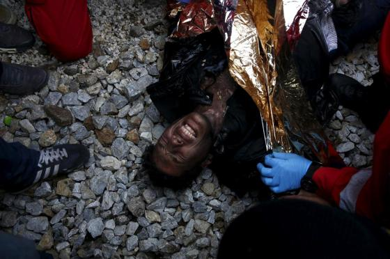 A stranded Moroccan migrant is aided by first aid personnel after being electrocuted at the rail tracks next to the Greek-FYROM  borders, near the village of Idomeni, Greece, November 28, 2015. REUTERS/Giorgos Moutafis