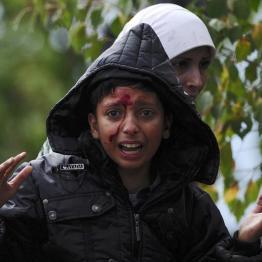 A girl cries after crossing Greece's border into FYROM near Gevgelija, FYROM , August 22, 2015. REUTERS/Ognen Teofilovski