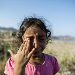 Yasmine, a 6-year-old migrant from Deir Al Zour in war-torn Syria, cries at the beach after arriving on the Greek island of Lesbos September 11, 2015. REUTERS/Zohra Bensemra