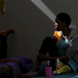 A migrant drinks water on the deck of the Medecins san Frontiere (MSF) rescue ship Bourbon Argos somewhere between Libya and Sicily August 8, 2015. REUTERS/Darrin Zammit Lupi