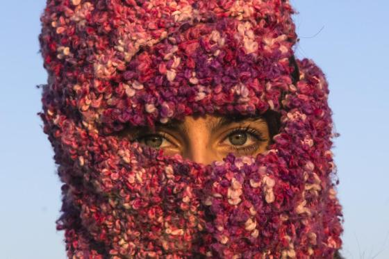 A woman from Syria looks on as she waits to cross the border with Croatia near the village of Berkasovo, Serbia, October 21, 2015. REUTERS/Marko Djurica