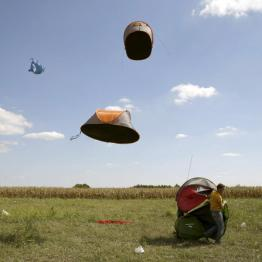 Migrants' tents are blown off by the wind near a collection point in the village of Roszke, Hungary September 9, 2015. REUTERS/Marko Djurica