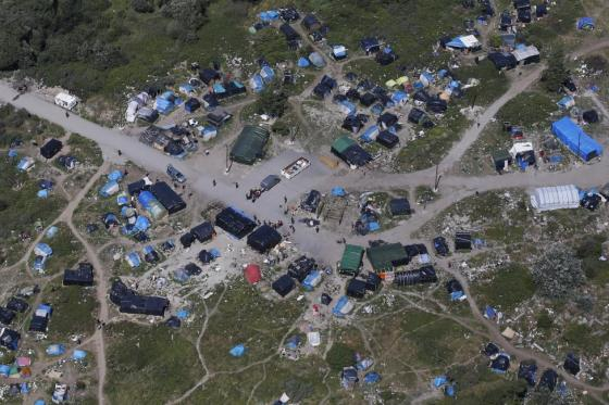 """An aerial view shows a field named """"new jungle"""" with tents and makeshift shelters where migrants and asylum seekers stay in Calais, northern France, July 21, 2015. REUTERS/Pascal Rossignol"""