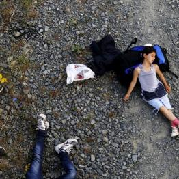 Seven year-old Ariana, a Kurdish-Syrian immigrant, rests before crossing into FYROM along with another 45 Syrian immigrants near the border Greek village of Idomeni in Kilkis prefecture May 14, 2015. REUTERS/Yannis Behrakis