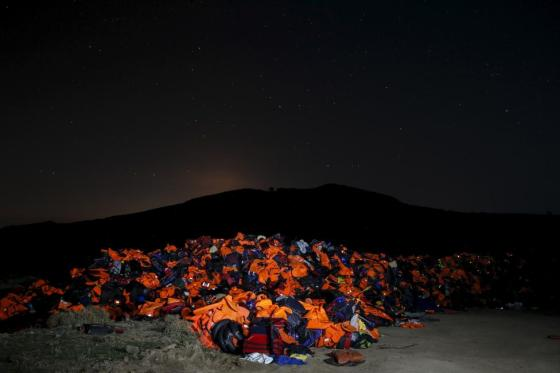 A long exposure photo shows thousands of lifejackets left by migrants and refugees, piled up at a garbage dump site on the Greek island of Lesbos, November 9, 2015. REUTERS/Alkis Konstantinidis