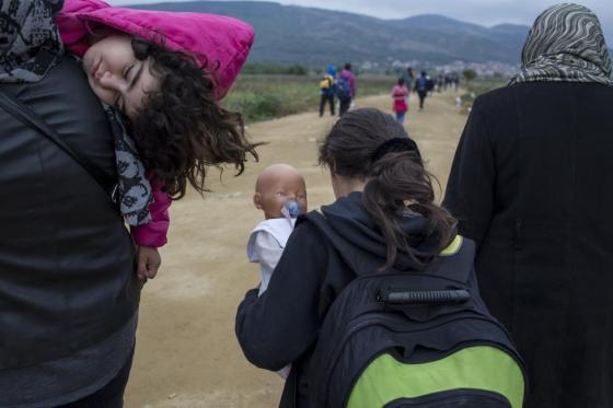 A young girl carries a doll as she and other migrants make their way after crossing the border from Macedonia, at Miratovac, Serbia October 15, 2015. REUTERS/Marko Djurica