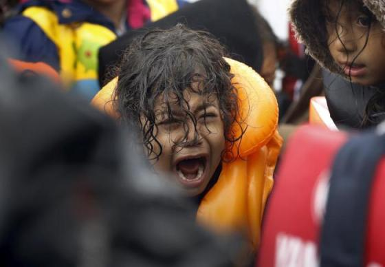 A Syrian refugee child screams inside an overcrowded dinghy after crossing part of the Aegean Sea from Turkey to the Greek island of Lesbos September 23, 2015. REUTERS/Yannis Behrakis