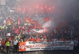 """Protestors hold a banner reading """"You do not negotiate social setbacks, together let's impose social progress. No to scrapping labor law"""", during a day of strikes and protest, in Marseille, southern France, Thursday, June 14, 2016. Workers strike across sectors of the French economy and march through French cities in what unions hope is a huge outpouring of discontent at changes to labor protections and a big challenge to the government. (AP Photo/Claude Paris)"""