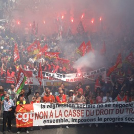 "Protestors hold a banner reading ""You do not negotiate social setbacks, together let's impose social progress. No to scrapping labor law"", during a day of strikes and protest, in Marseille, southern France, Thursday, June 14, 2016. Workers strike across sectors of the French economy and march through French cities in what unions hope is a huge outpouring of discontent at changes to labor protections and a big challenge to the government. (AP Photo/Claude Paris)"
