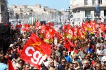 Workers hold CGT Union's flags during a day of strikes and protest, in Marseille, southern France, Thursday, June 14, 2016. Workers strike across sectors of the French economy and march through French cities in what unions hope is a huge outpouring of discontent at changes to labor protections and a big challenge to the government. (AP Photo/Claude Paris)