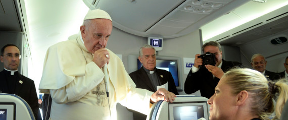 Pope Francis speaks to journalists during a press conference on the plane after his visit to Krakow,  for the World Youth Days