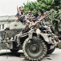 Cuban rebels pose atop a tank in Havana. 1959.