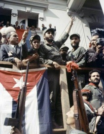 Fidel Castro and members of the July 26 Movement stand in front of Fulgencio Batista's palace in Havana, declaring victory for the revolution after news breaks that Batista has fled Cuba. 1 January 1959