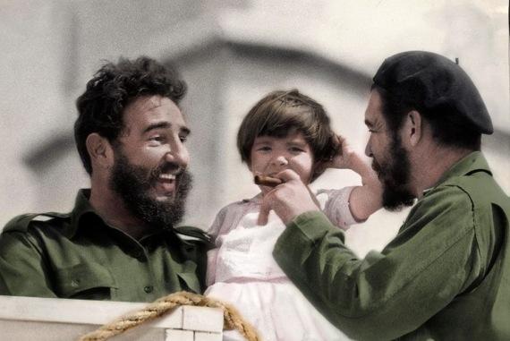 Che Guevara, his daughter Aleida and Fidel Castro, in Havana, circa 1963.