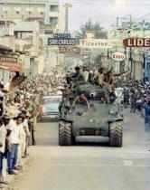 Cuban revolutionaries parade in captured government tanks, 1959