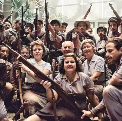 Armed Cuban revolutionaries fill the lobby of the Hilton Hotel. Havana, Cuba. 1959.