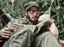 Fidel Castro in the jungle reading a newspaper. Circa 1958.