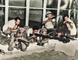 Cuban revolutionaries under the command of Che Guevara attack an army post during the Battle of Santa-Clara. December 1958
