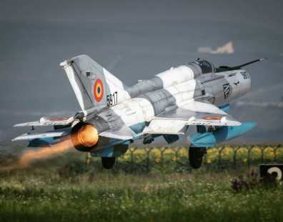 Romanian Air Force MiG-21 LanceR plane rear view afterburner full thrust