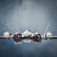 T-50 Sukhoi plane rear view afterburner full thrust